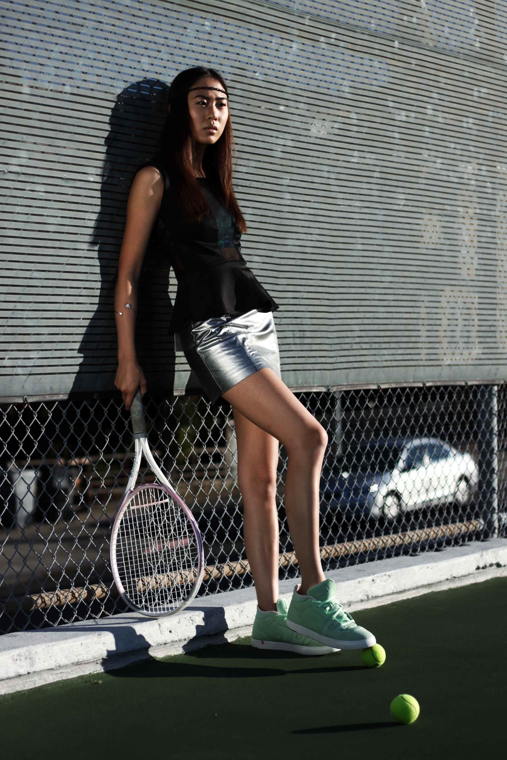 Headband, Bracelet: Sway; Bra, Shoes: Stylist's own; Top, Skirt: LF Store; Tennis racket, balls: Model's own